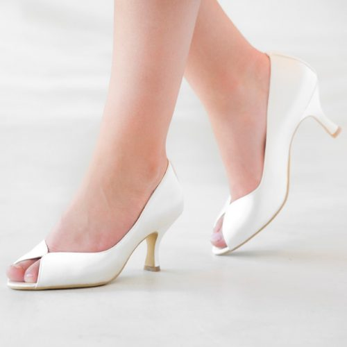 Classic white coloured enclosed bridal shoe