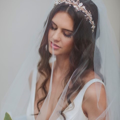 bride wearing headband in KWH dress (Small)